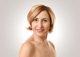 Mature woman on light background