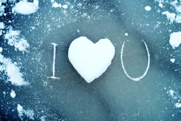 "Heart from snow on ice. Snow Heart and text ""I love you"". Love concept. Valentine background."