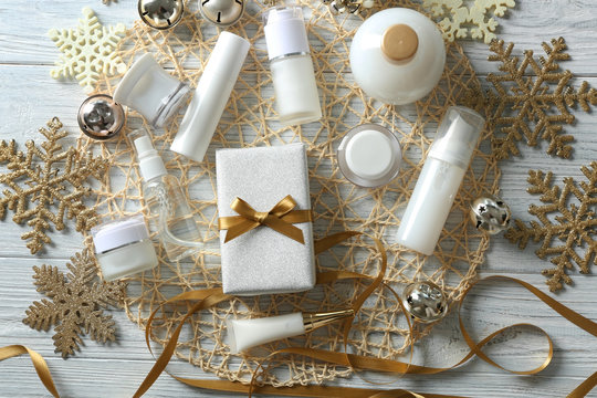 Christmas gift with beauty cosmetic products and decoration on wicker mat