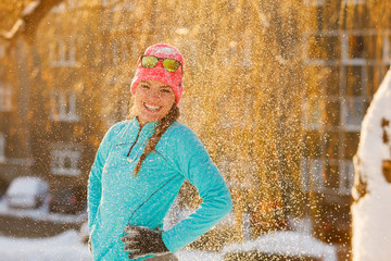 Girl standing in falling snow