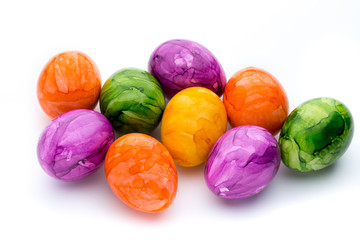 Easter eggs painted in colors on a white background.