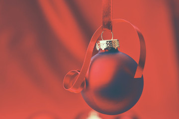 Christmas red balls on a bowl, on red background