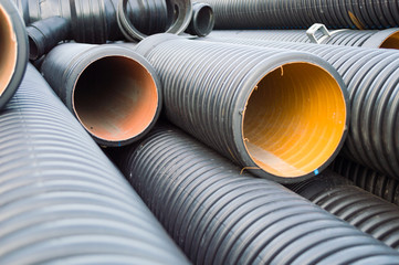Perspective view of garnered black plastic substructure pipes