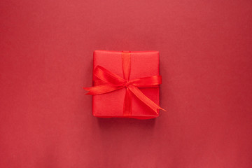 red gift box on craft background