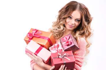 Cheerful girl with gift boxes.