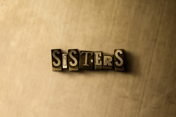 SISTERS - close-up of grungy vintage typeset word on metal backdrop. Royalty free stock - 3D rendered stock image.  Can be used for online banner ads and direct mail.
