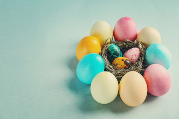 Composition of Easter eggs on color background