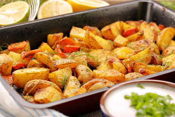 Fresh baked potatoes with herbs and lemon dip