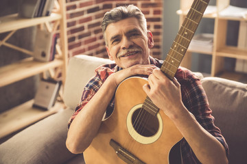 Handsome mature man with guitar