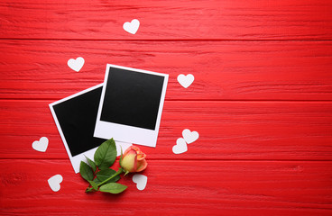 Photo cards with flower on red table