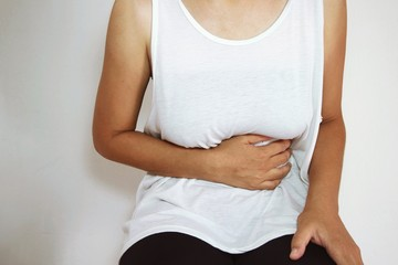 woman stomach ache because of gastritis or menstruation
