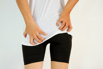 Young woman has itching the buttocks, Healthcare concept.