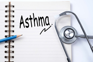 Stethoscope on notebook and pencil with Asthma words as medical