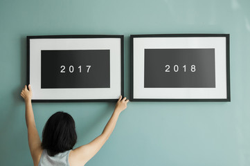 Woman holding picture frame. New year concept.