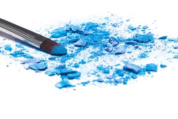 Crushed compact blue eyeshadow on white background