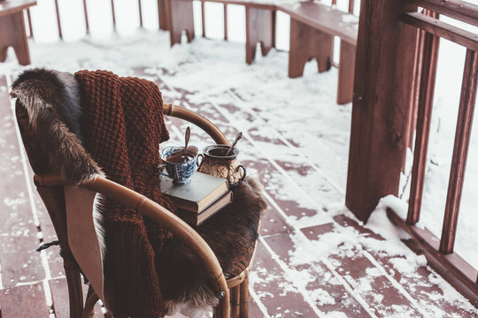 Porch of log cabine with snow
