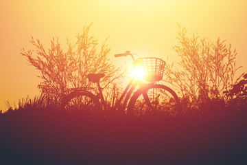 vintage bike  with beautiful landscape image on sunset.