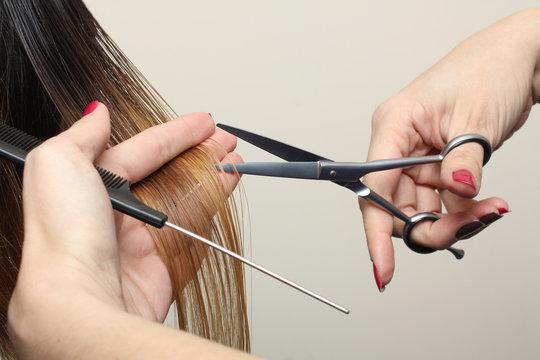 Hairdresser do haircut close up