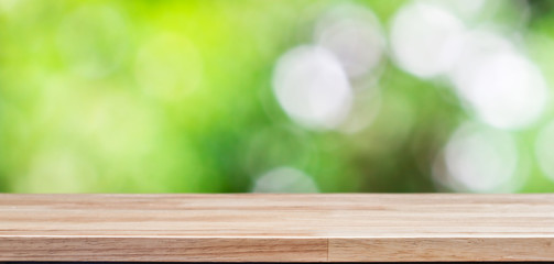 Wood table top on bokeh green background