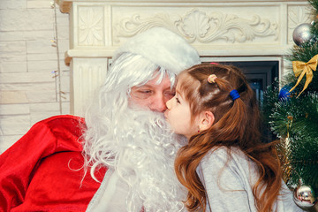 Santa Claus with a little girl.