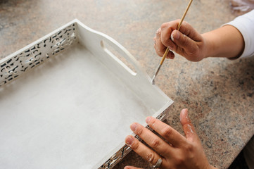 painter paint a white wood vinatge box for decoration nice