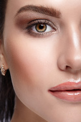 Half face female beauty portrait with day  makeup