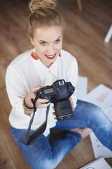 Female artist woman examining radical photos
