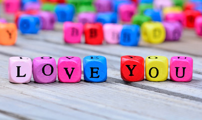 Love you words on table