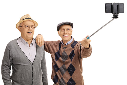 Cheerful seniors taking a selfie with a selfie stick