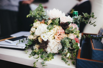 The wedding bouquet stands on the table