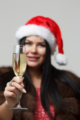 Christmas brunette with champagne glass