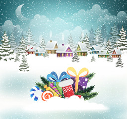 Snow-covered village and Christmas presents
