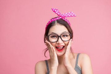 Fashion portrait of asian girl with sunglasses standing on pink