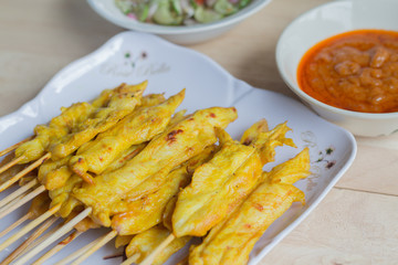 Grilled chicken satay with peanut sauce and vinegar of vegetable