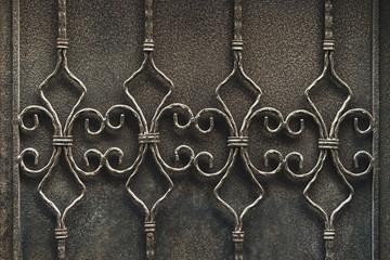 Vintage metal decoration. Forge element on black background