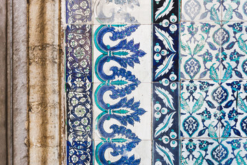 Seamless pattern white Turkish tiles with blue ornaments. Old