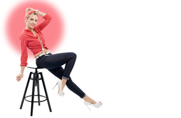 beautiful blonde woman in retro style sitting on stool
