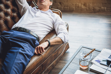 Tired man lying on couch