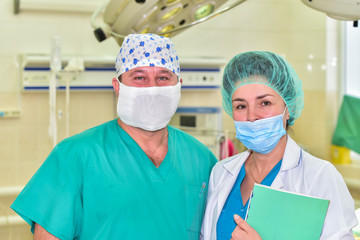 Doctors colleagues/Photo doctors colleagues on the background of the operating room in the clinic