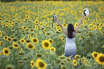 girl feel happy in sunflower farm