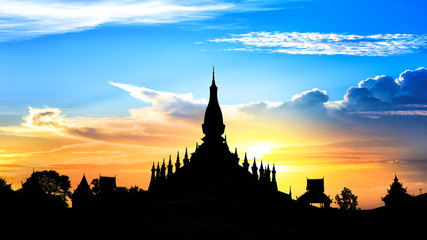 Laos travel landmark, golden pagoda wat Phra That Luang at sunset sky in Vientiane, Buddhist temple, Religious architecture and landmarks, Famous tourist destination in Asia.