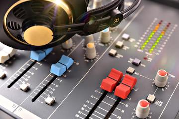 Headphones on mixer in studio
