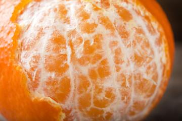 Close up of one peeled orange