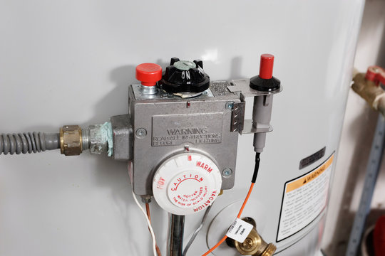 Water temperature controls on a replacement home hot water heater