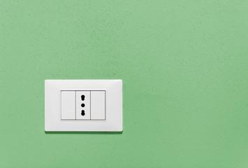 Empty Wall Socket on a Green Wall