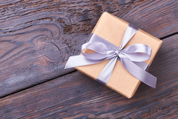 Wrapped gift box with bow. Ribbon on present box. Gift for the long memory.