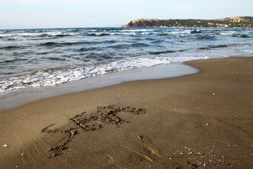 sea written on the beach near Mudanya in Bursa