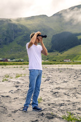 Young photographer is taking a picture in Norway