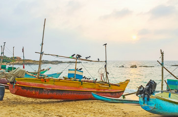 The fishing boats on sunset
