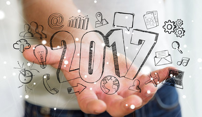 Businessman holding 2017 hand drawn text Fototapete